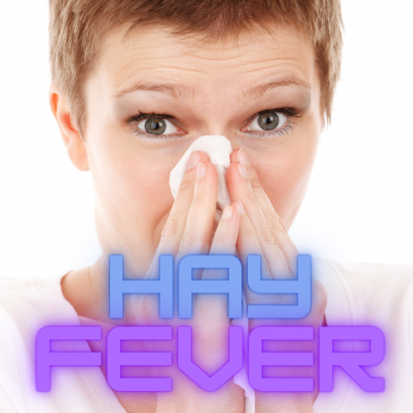 woman with tissue at her nose, suffering from hay fever